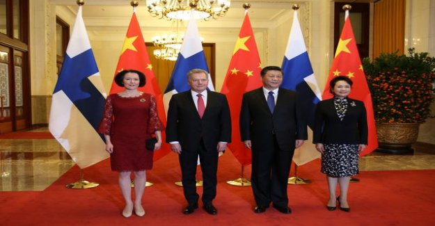 The president and first lady represents in China – Jenni Haukio in the chic in the red takes the attention of the official in the picture