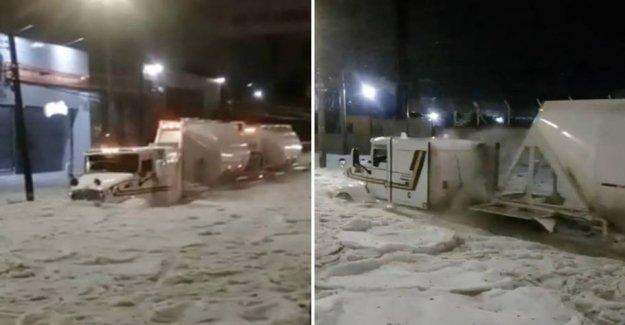 Braving storms: Truck plows through metertykt islag