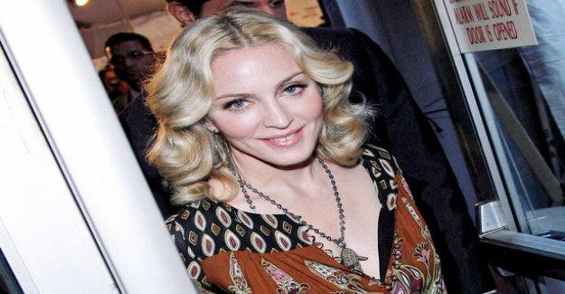 Madonna comments butt implants stir - doesn't need the approval of others