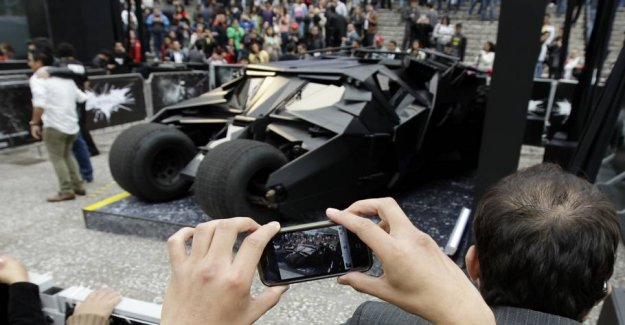 Spewing fire and howls: Love the batmobil must at auction