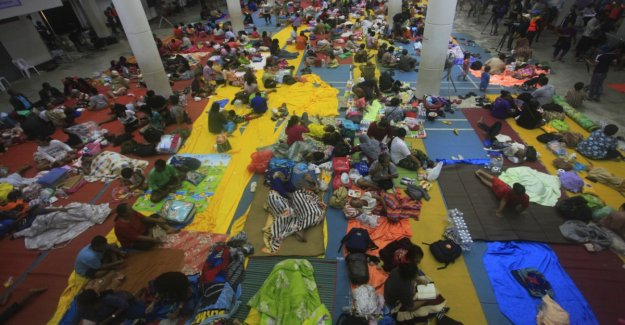 Tens of thousands flee ahead of a tropical storm