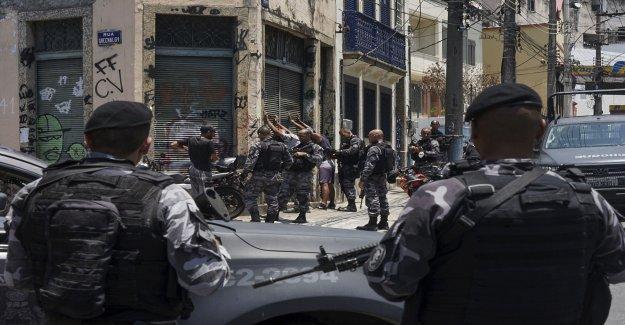 At least 13 dead in clashes in Rio