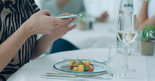 Sign with a message in fight against foodstagramming': Enjoy the food, but especially each other