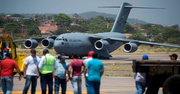 US plane with humanitarian aid to Venezuela lands in the border