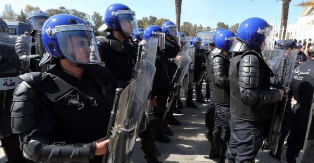 Police turn water cannon and tear gas in riots in Algeria