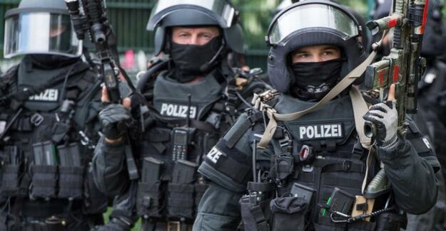 Raids arrested for suspicion of terror : Ten suspected Islamists firmly