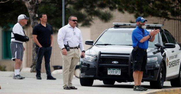 Armed woman threatening school shootings
