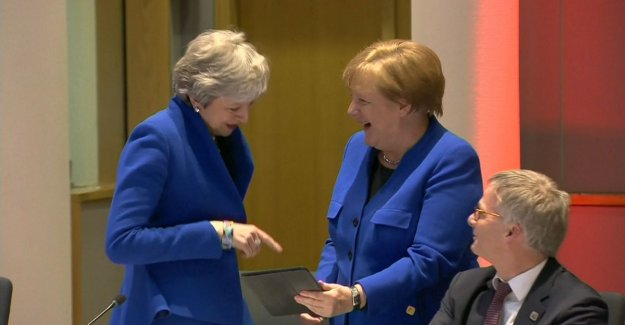 Hilarity on brexittop: May and Merkel laughing at the same outfit