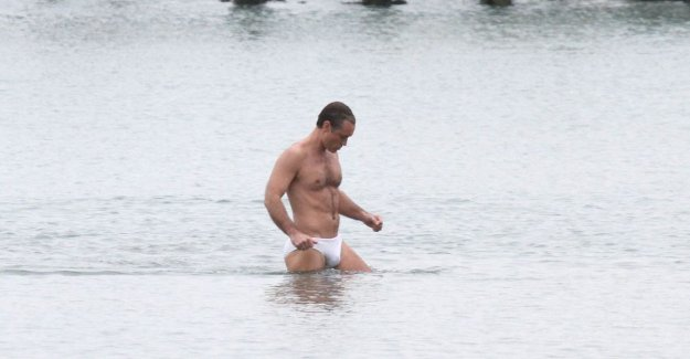 IN THE PICTURE. Jude Law shines in mini swimsuit