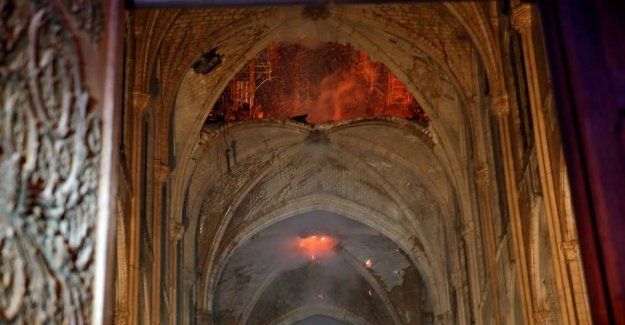Macron promises to rebuild Notre Dame