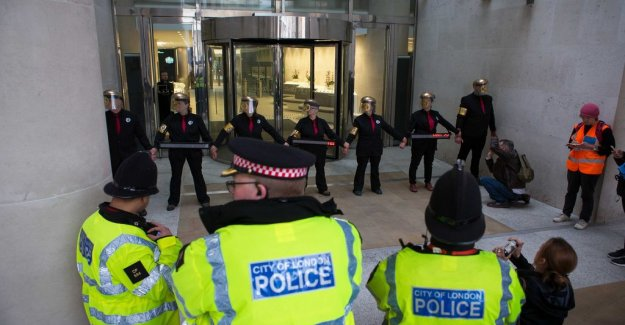 Protesters glued at the London stock exchange