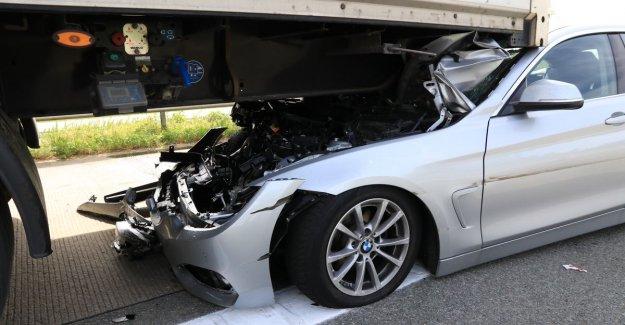 VIDEO. Director slide with BMW under semi-trailer