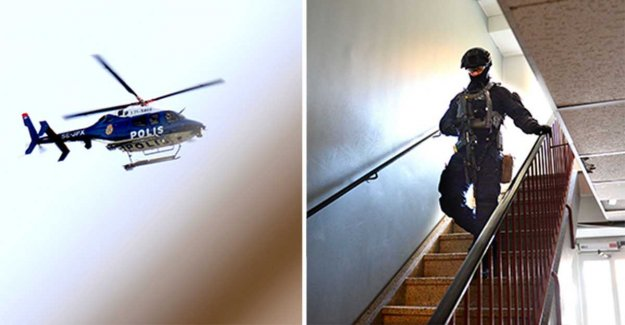 The police conduct dawn raid in Västerås, sweden – helicopter in the air