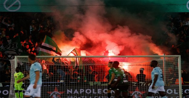 Supporters are going to have the wrote this in the Bruges derby, flag, Club Brugge are set on fire and fireworks on the pitch