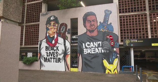 A mural in tribute to George Floyd painted in front of a police station in Grenoble