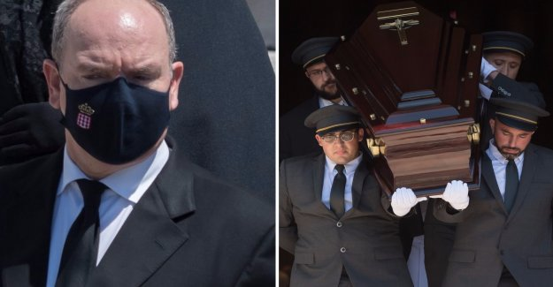 The prince Albert, in black mask, during a cousin's funeral