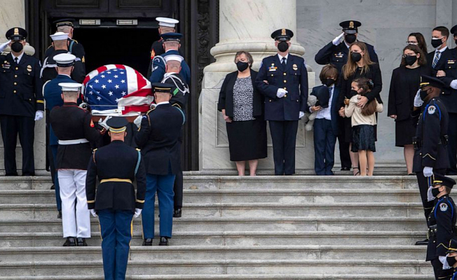 Officer killed in Assault lies in honor in Capitol Rotunda