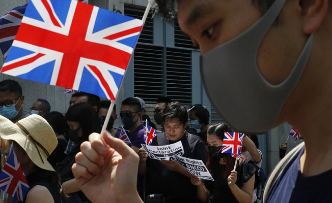 Hong Kong bans passenger flights from the UK in an effort to stop spreading of the virus