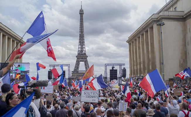 French protesters reject bill that requires vaccine passes
