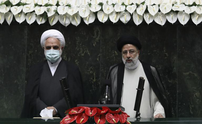 Iran swears in a new president hardline amid tensions within the region
