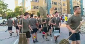 The chinese army soldiers appeared to clean up Hong kong streets